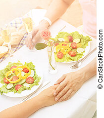 Couple holding hands - Toned picture of beautiful couple...