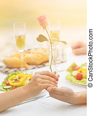 Couple holding hands - Dating, lunch or dinner concept....
