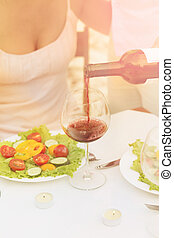 Sommelier - Toned picture of sommelier pouring red wine in...