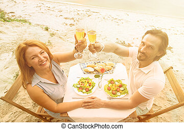 Mature couple outdoor - Toned picture of handsome man and...