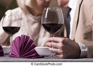 Drink for one true love - Close-up of glass of red wine hold...