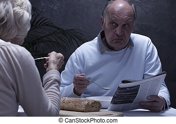 Silence and loneliness in marriage - Senior angry man...