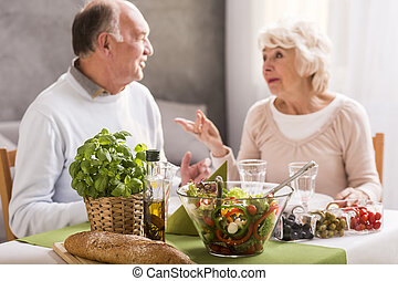 Romantic dinner at home - Elderly married couple in love...
