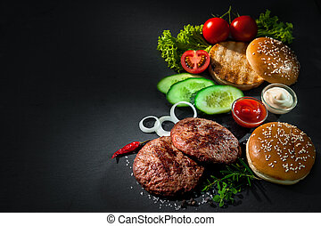 Grilled beef patties with other ingredients for hamburgers -...