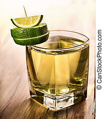 Glass green transparent drink decorated lime. - Alcohol...