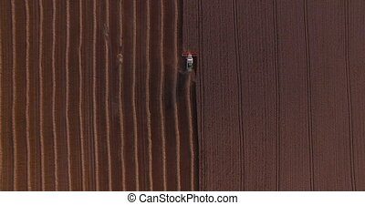 harvester threshing wheat aerial view.