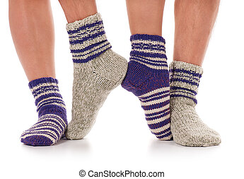 Warm knitted socks - Pair of man and woman in the knitted...