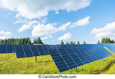 Photovoltaics panels on a meadow - Solar panels for ecologic...