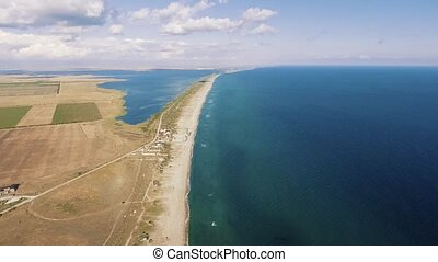 Aerial shoot of the Black Sea coastline and lake from copter