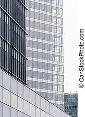 Extreme close up building windows. Isolated vertical view of modern commercial office building with vertical windows, architectural exterior.