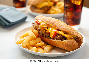 Cheesesteak sandwich - cheesesteak sandwich accompanied by...