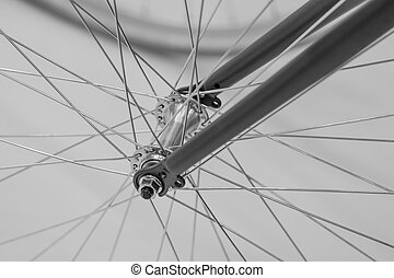 Bicycle spoke detail closeup. Black and white detail view with hub and spokes of one bicycle wheel.