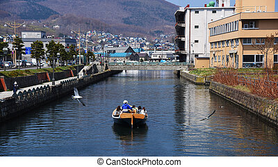 people sightseeing Otaru canal by boat - tourist people on a...