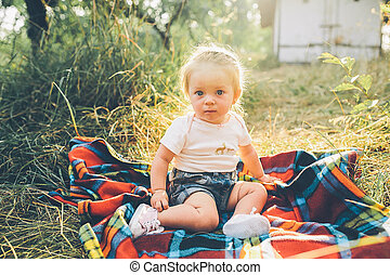 little girl sitting on the lawn