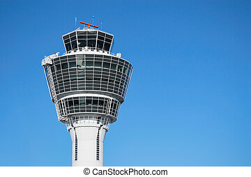 Munich air traffic control tower against clear blue sky -...