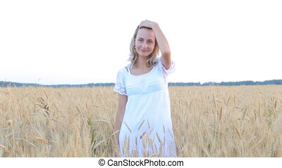 Beauty Girl with Healthy Hair Outdoors. Happy Smiling Young Woman falling