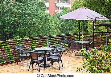 Patio rattan chairs and table in raining - Modern set of...