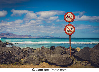 Forbidding signs - No swimming, no fishing signs on the...