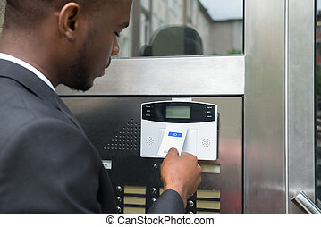 Businessman Using Keycard To Open Door - Close-up Of Young...