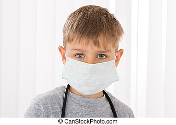 Boy Doctor With Surgical Mask - Portrait Of A Boy Doctor...