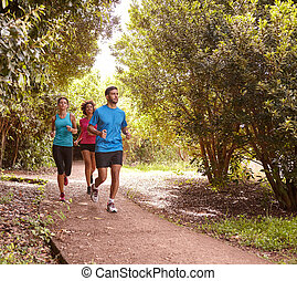 Three young friends jogging for fun