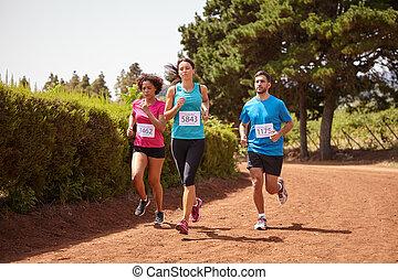 Three friends running a fun race