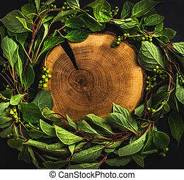 Background with Schisandra chinensis wreath around wooden...