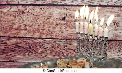 Jewish holiday Hanukkah creative background with menorah. View from above focus on .