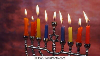 Jewish holiday hannukah symbols - menorah and wooden...