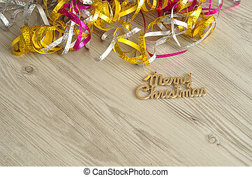 Merry Christmas isolated on a wooden background with a...