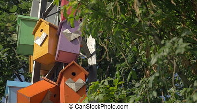 Colorful birdhouses in the park - Installation of multicolor...