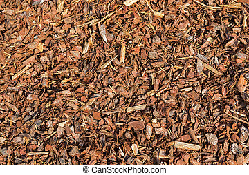 Coarse dried Pine Bark Nuggets ideal for topping garden bed to retain moisture