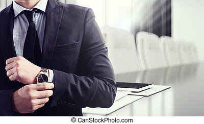 Business meeting - Businessman with clock and meeting desk...