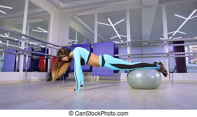 Woman doing exercise in the gym. - Sportive young woman...