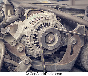 Old car alternator - Old alternator for the car attached on...