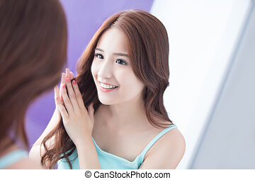 young woman is touching hair