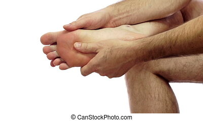 Male Foot Pain Isolated on White - Closeup of an anonymous...