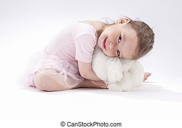 Portrait of Cute Caucasian Female Kid Sitting Together with...