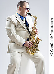 Music Concepts Hadnsome Male Saxophone Player Playing in...