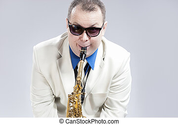 Funny Humorous Male Saxophone Player Performing On Alto Saxo...