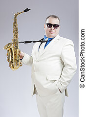 Male Saxo Player in Stylish White Suit and Sunglasses Posing...