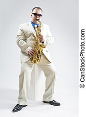 Music Concepts and Ideas Portrait of Hadnsome Male Saxophone...