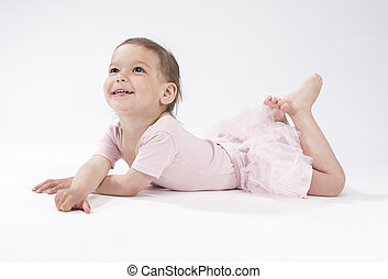 Lovely and Cute Caucasian Female Child Laying on Floor...