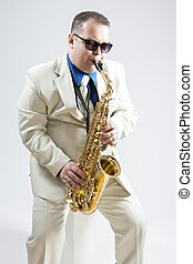 Portrait of Expressive Stylish Caucasian Saxophone Player...