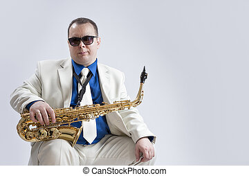 Portrait of Caucasian Saxophone Player Posing with...