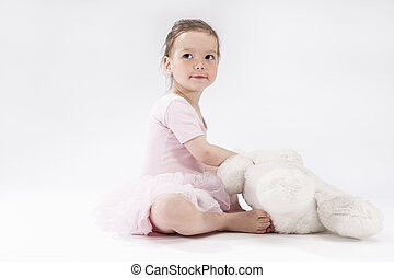Cute Little Caucasian Child with Big Plush Toy Sitting and...