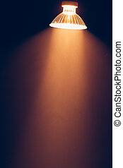 halogen lamp with reflector, warm light in haze