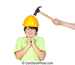 Frightened child with yellow helmet and hammer over a white...