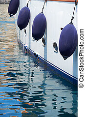 A Fender hanging on the yacht board. Malta.