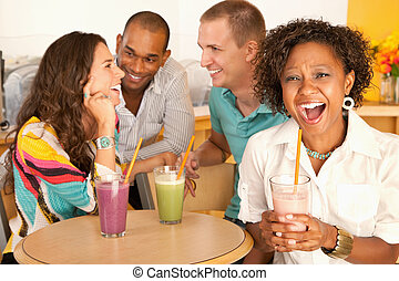 Group of Friends Talking - A group of young friends are...